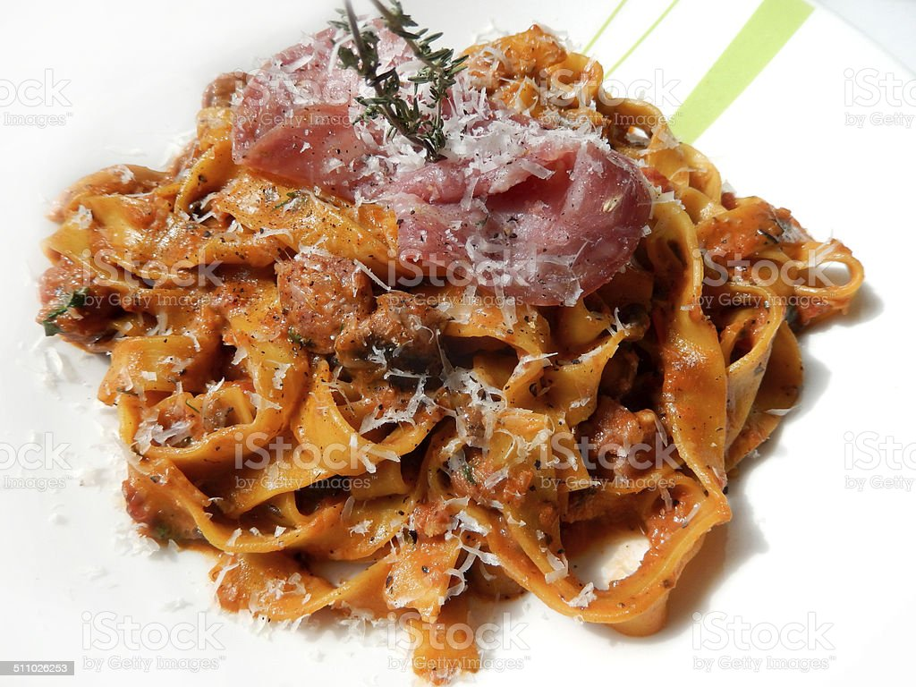Image of tagliatelle pasta with crispy pancetta ham, parmesan cheese stock photo