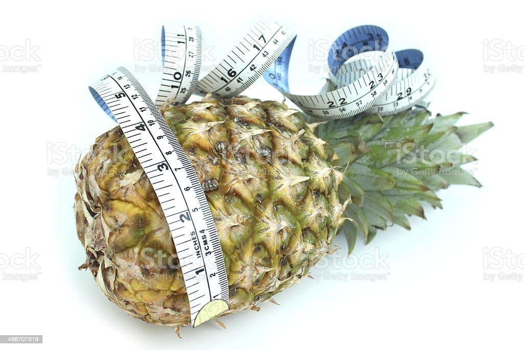 Image of tape measure with pineapple, fresh organic pineapple stock photo