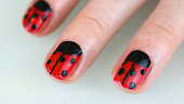 Image of teenage girl's fingernails painted with a ladybird design
