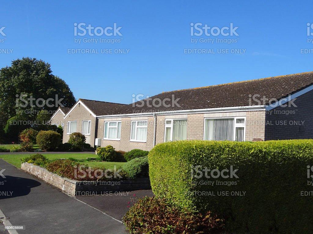 Image of terraced single-storey bungalows on elderly housing estate / seniors stock photo