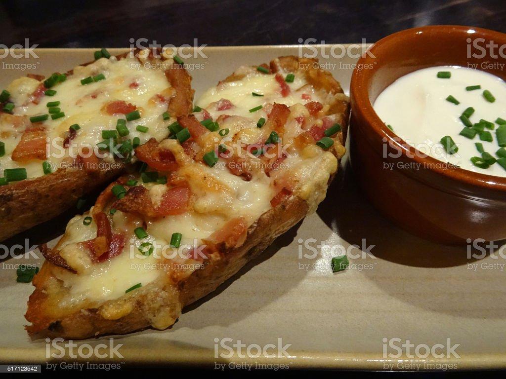 Image of tex-mex cuisine, potato skins, jack cheese, bacon, sour-cream stock photo
