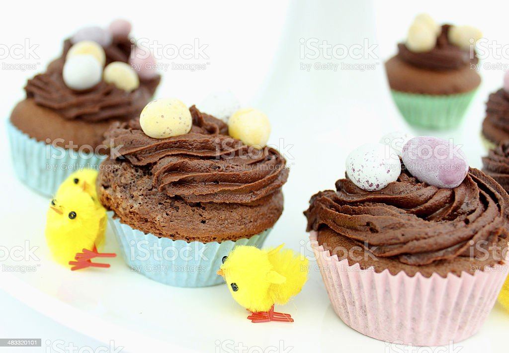 Image of tier on a cake stand displaying Easter cakes stock photo