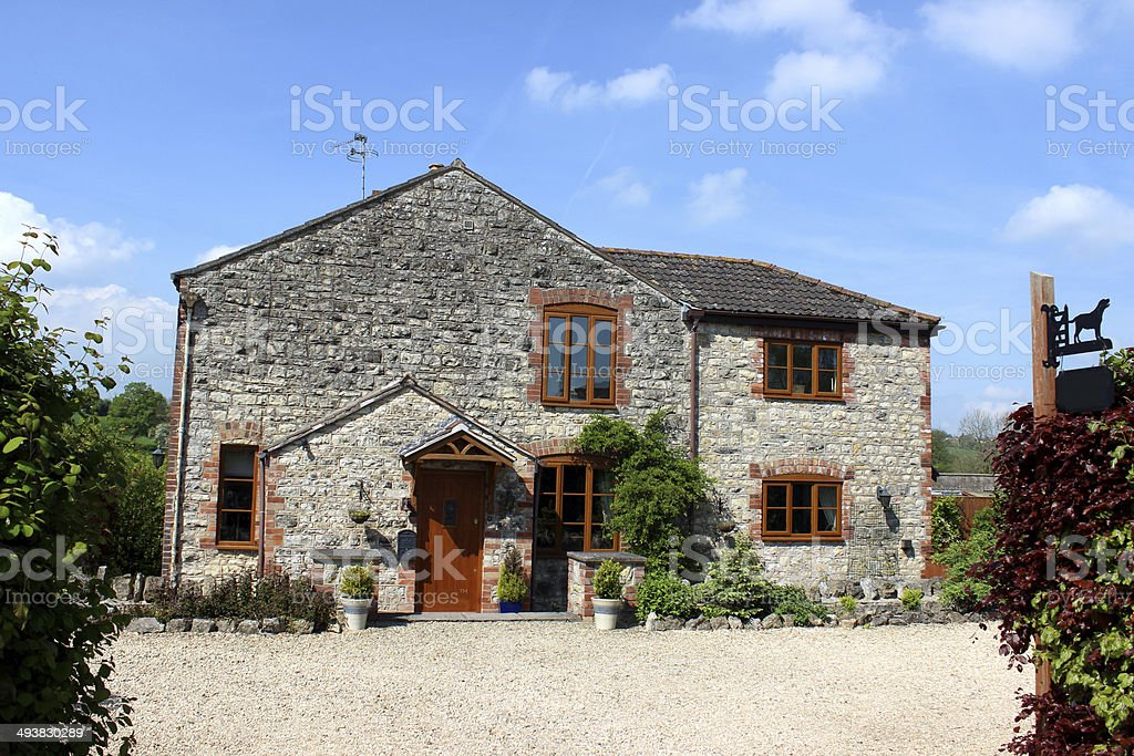 Image of traditional stone cottage villa in English countryside setting stock photo
