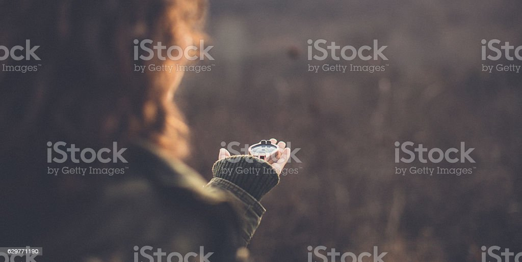 POV image of traveler woman with a compass stock photo