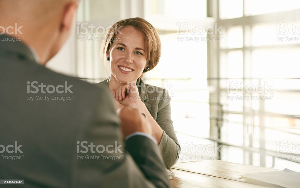 Image of two succesful business people conducting an interview to stock photo