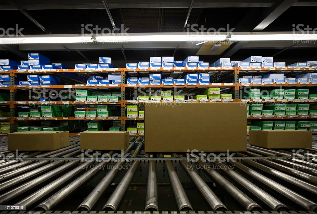 Image of warehouse full of boxes in green and blue stock photo
