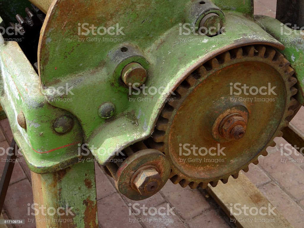 Image of weathered agricultural machinery, straight-cut gears, close up stock photo