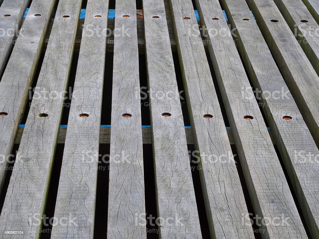 Image of weathered decking timber planks with wide spaced gaps stock photo