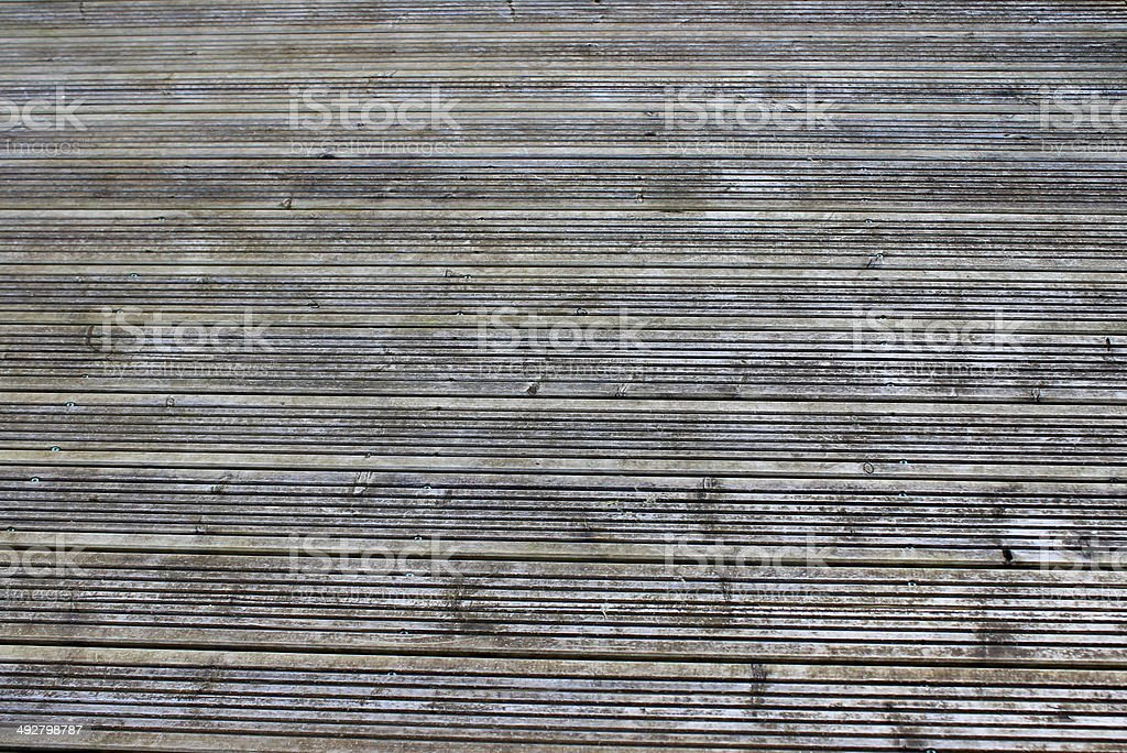 Image of weathered decking timber with no staining or preservatives stock photo