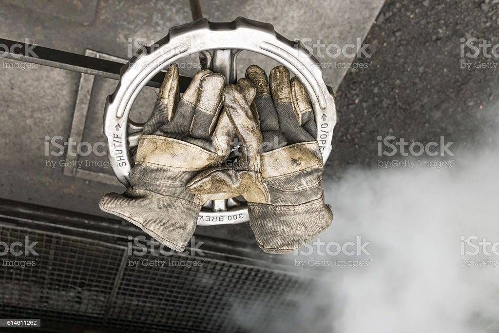 image of well worn leather work gloves stock photo