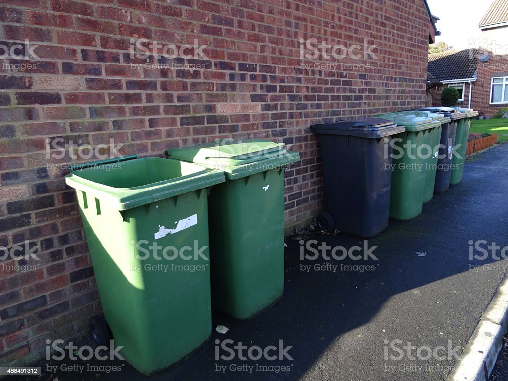 Image of wheelie bins lined up for refuse collection / bin-men stock photo