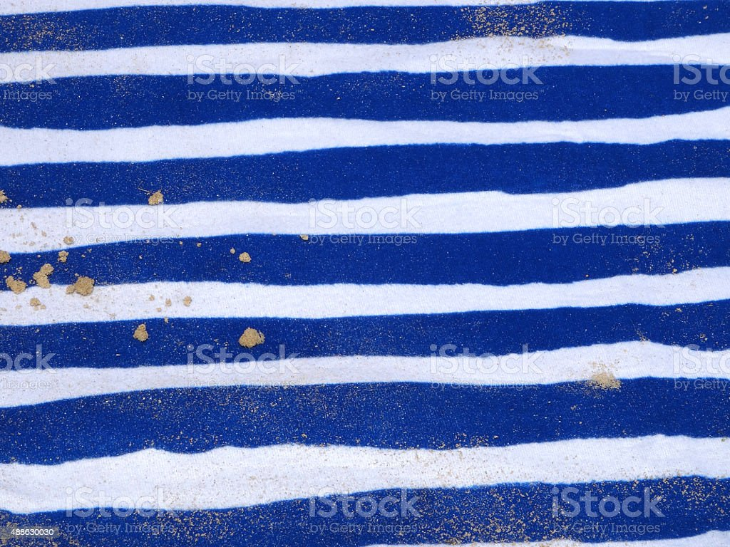 Image of white and blue beach mat / picnic-mat at seaside stock photo
