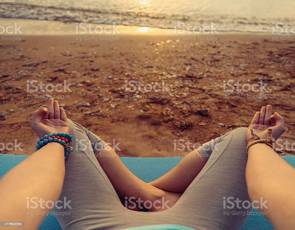 POV image of woman in pose of lotus stock photo