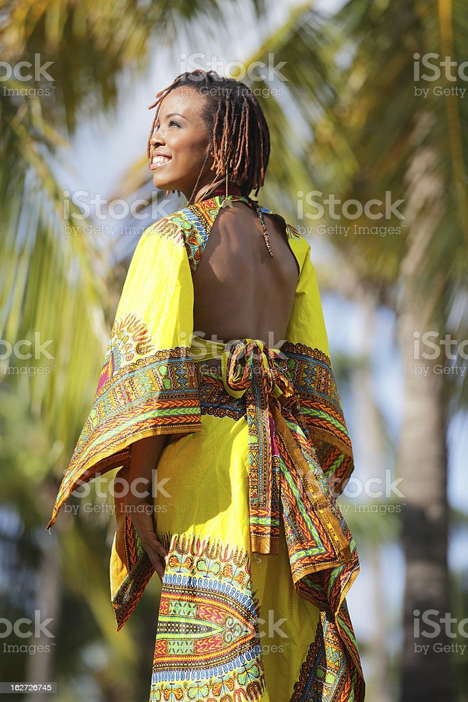 Image of woman smiling in a nature setting stock photo
