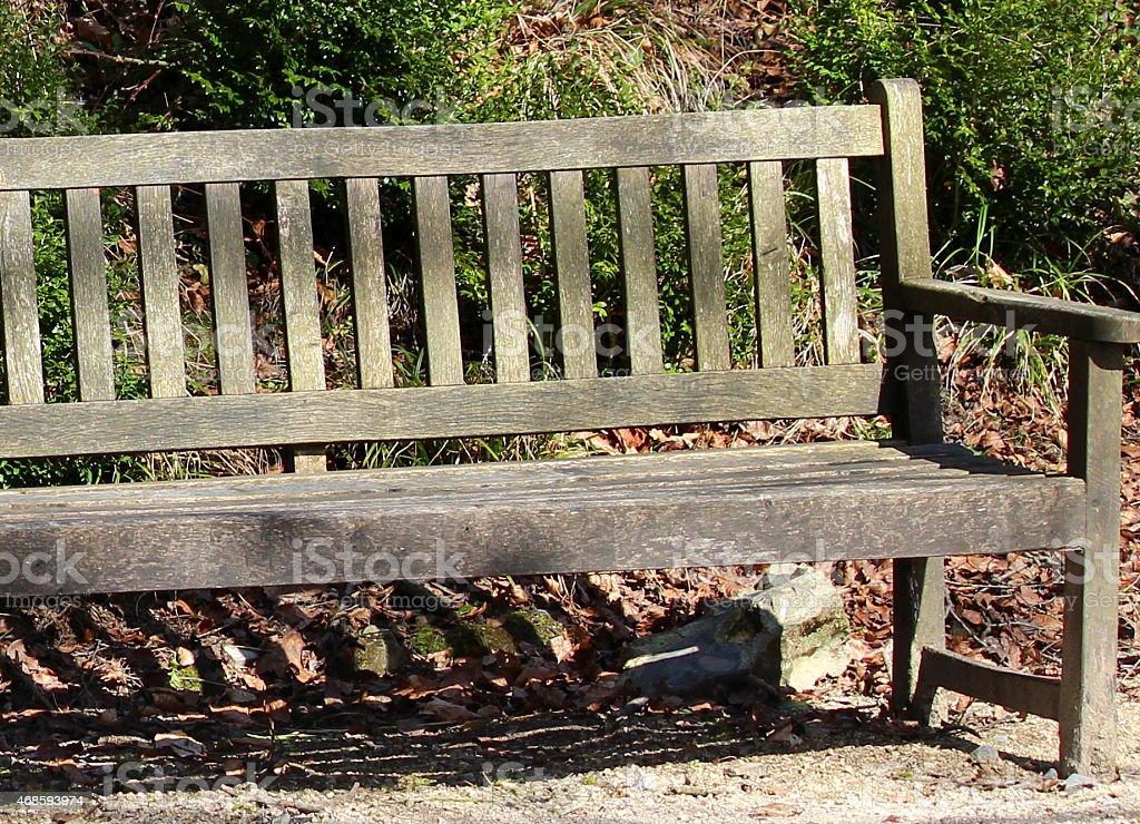 Image of wooden bench / seat, weathered teak hardwood garden furniture stock photo