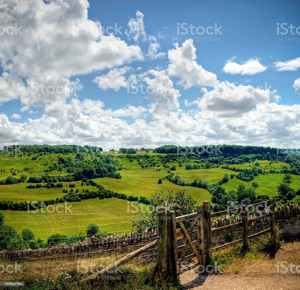 HDR image of wooden gateway with countryside backdrop, Cotswolds, Gloucestershire stock photo