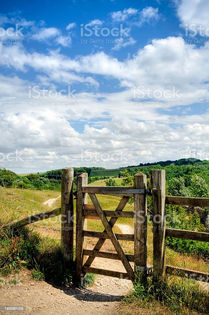 'HDR image of wooden gateway with countryside backdrop, Cotswolds' stock photo