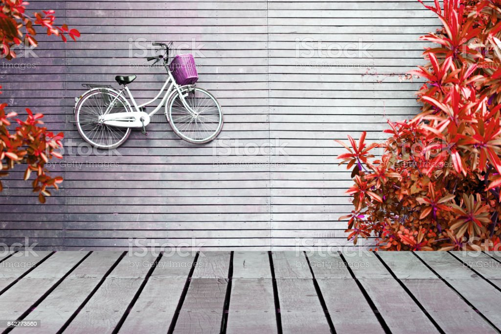 Image of wooden table in front of bicycle lying on wooden floor with trees along the way from top view, can used for display or montage your products. stock photo