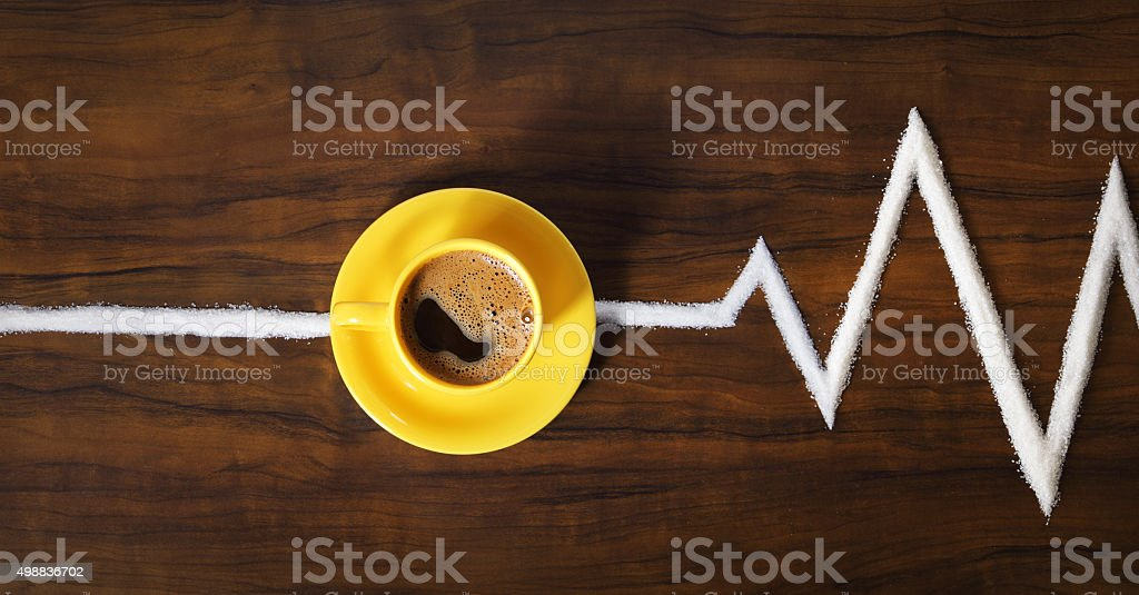 Image of yellow coffee cup and saucer on table stock photo