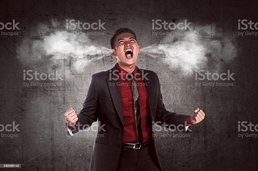Image of young asian businessman in anger stock photo