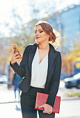 Image of young successful businesswoman in formal clothing
