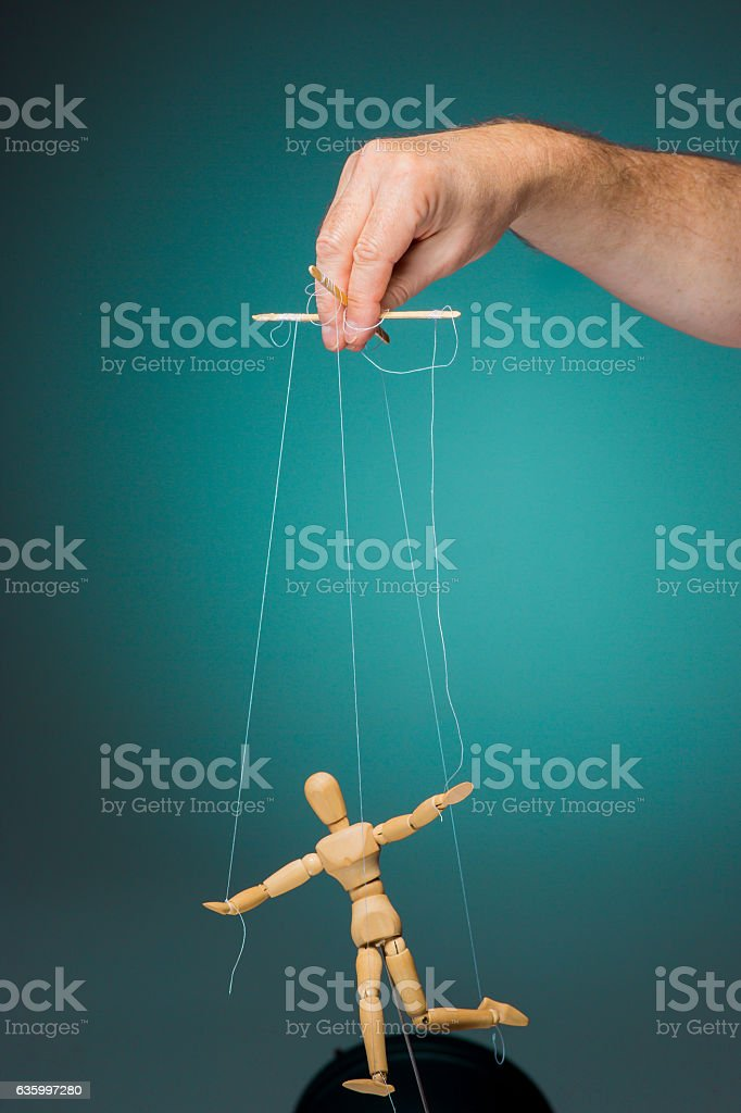 Image puppet in the hands of the puppeteer stock photo