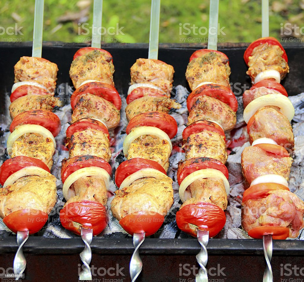 Image with fried meat, tomato and onion royalty-free stock photo