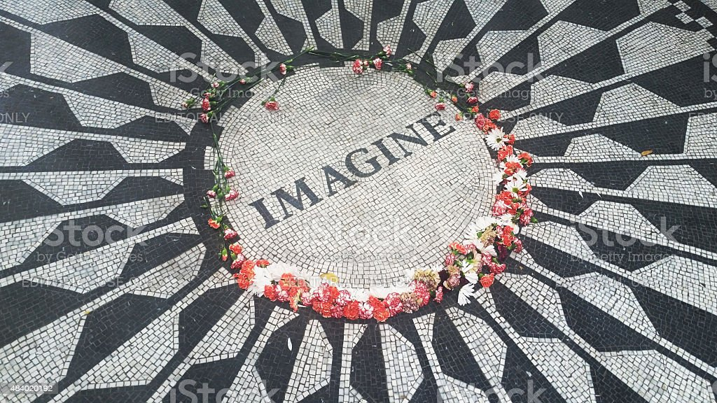 Imagine Mosaic Plaque and Flowers in Central Park stock photo