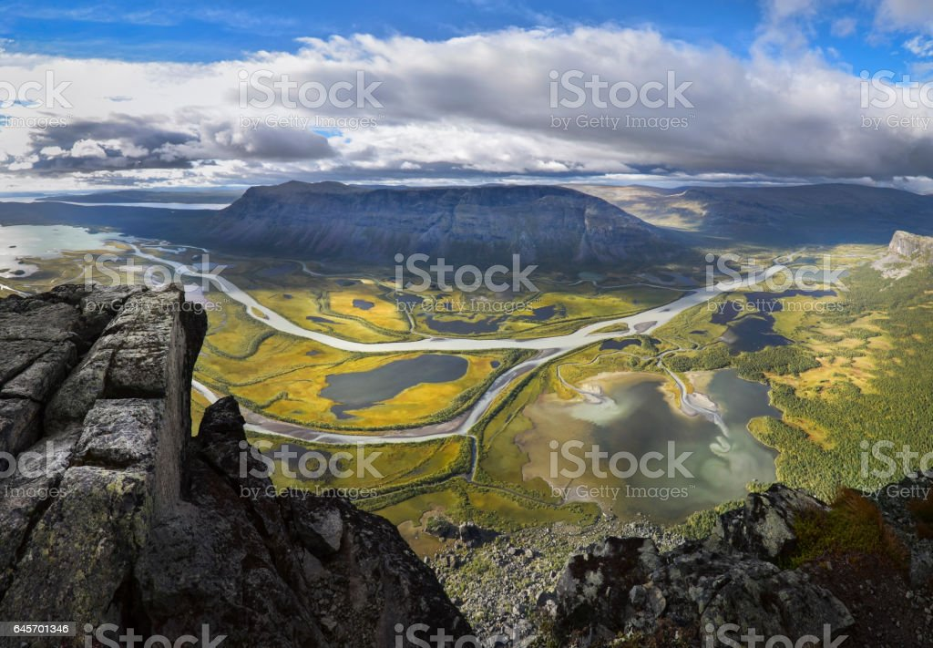 Imagine standing on the rock and looking at this beautiful panorama of this river delta landscape stock photo