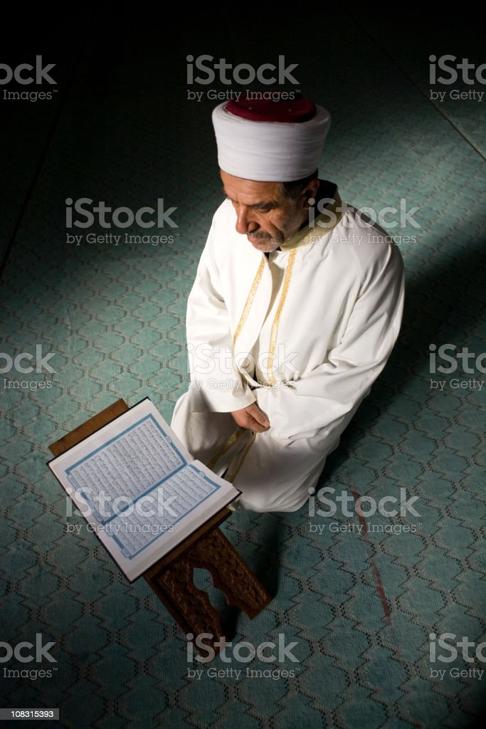 Imam reading Holly Quran stock photo