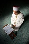 Imam reading Holly Quran