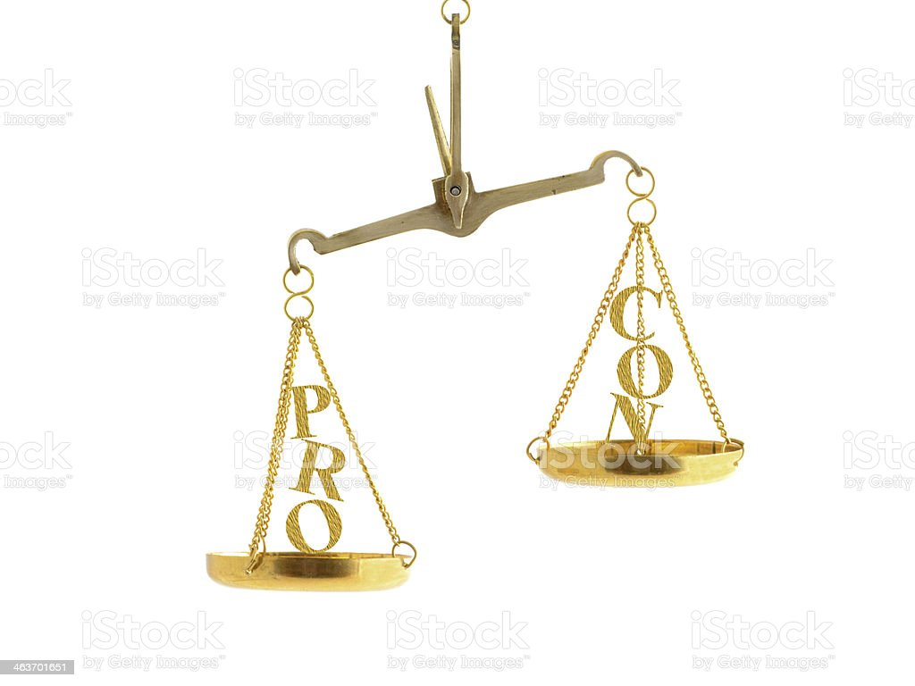 Imbalance between pro and con on scale stock photo