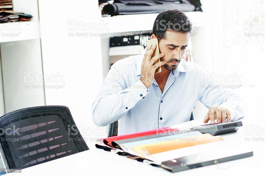 Imitation leather shop phone call business man stock photo