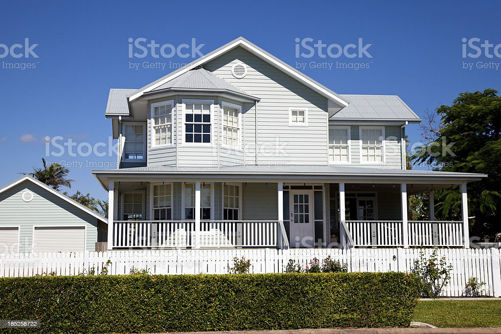 Immaculate Colonial Home with blue sky stock photo