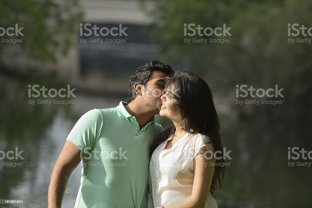 Immigrant couple from Pakistan kissing royalty-free stock photo