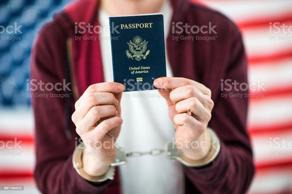 Immigrant Under Arrest stock photo