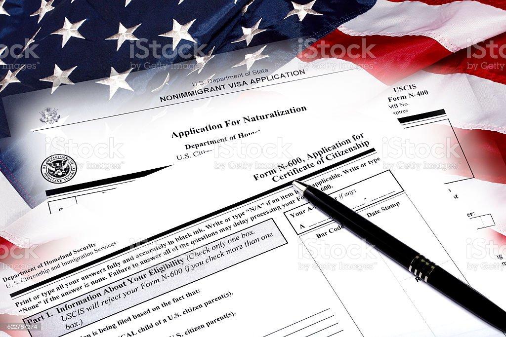 USA Immigration Applications Closeup on USA flag stock photo