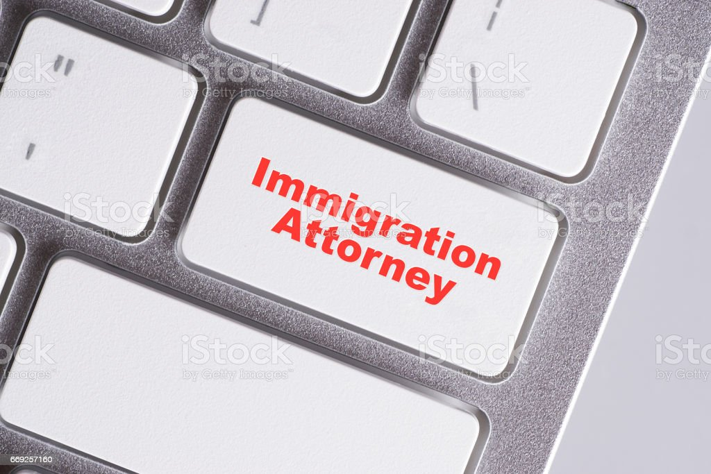 'Immigration attorney' red words on white keyboard - online, education and business concept stock photo