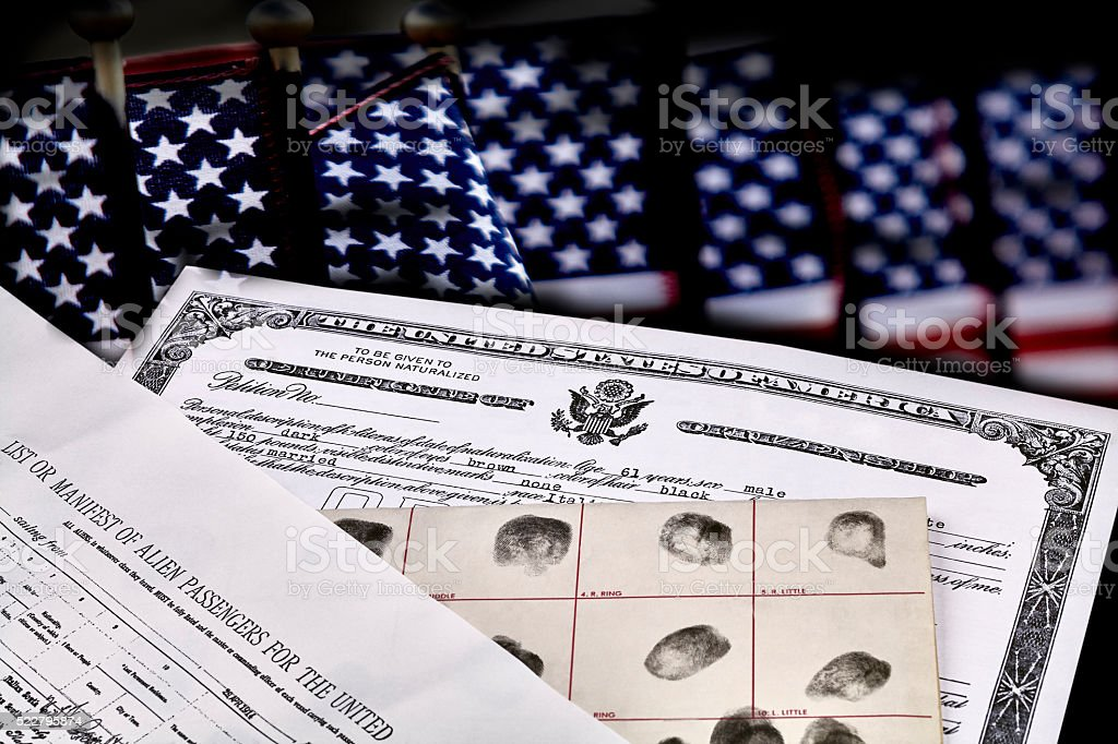 Immigration Documents with US Flags stock photo