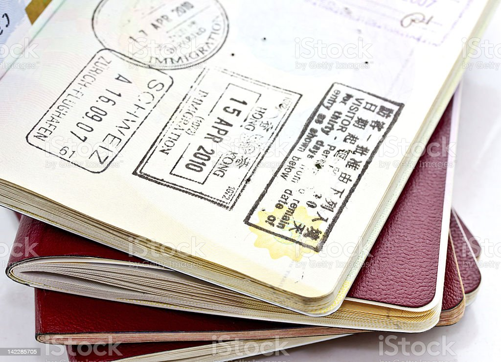Immigration stamps on passport stock photo