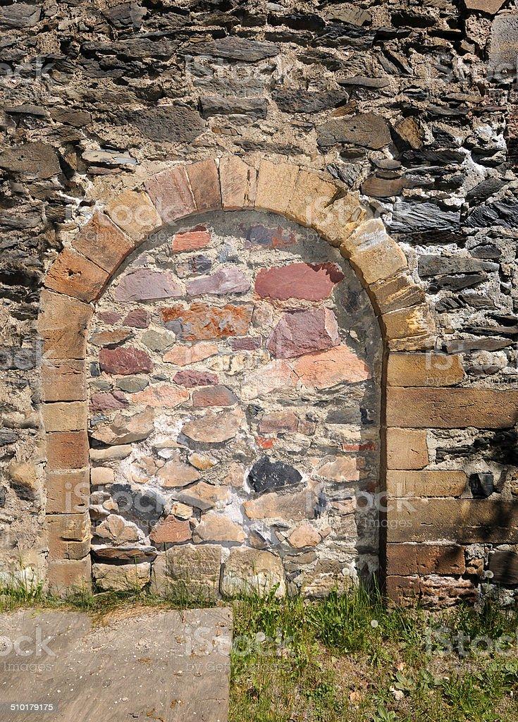 immured arched doorway stock photo