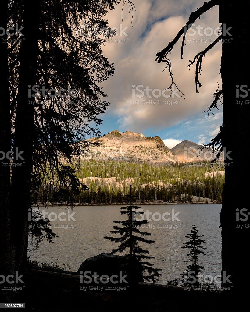Imogene Lake Idaho with mountain peak and clouds stock photo