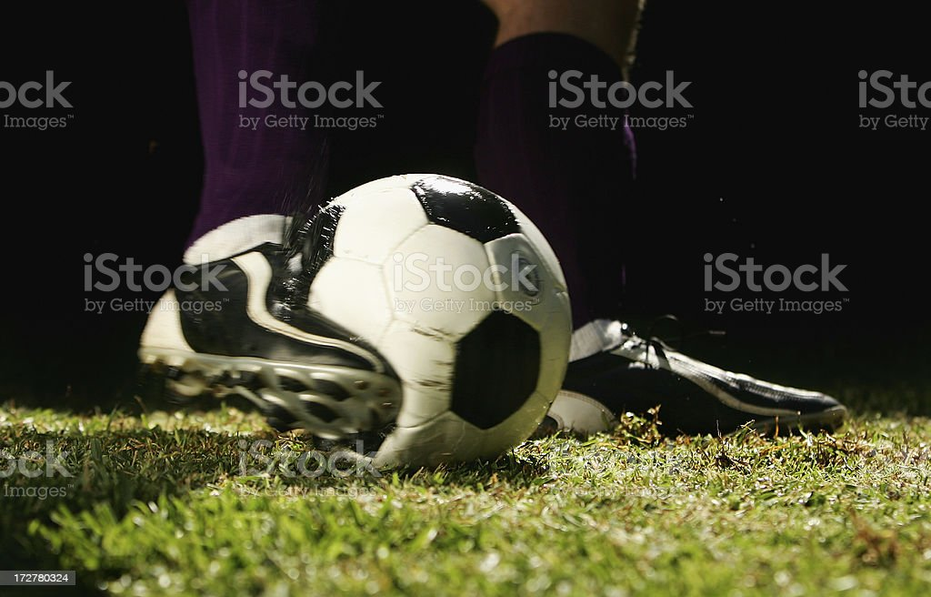 Impact as a Football is Kicked royalty-free stock photo