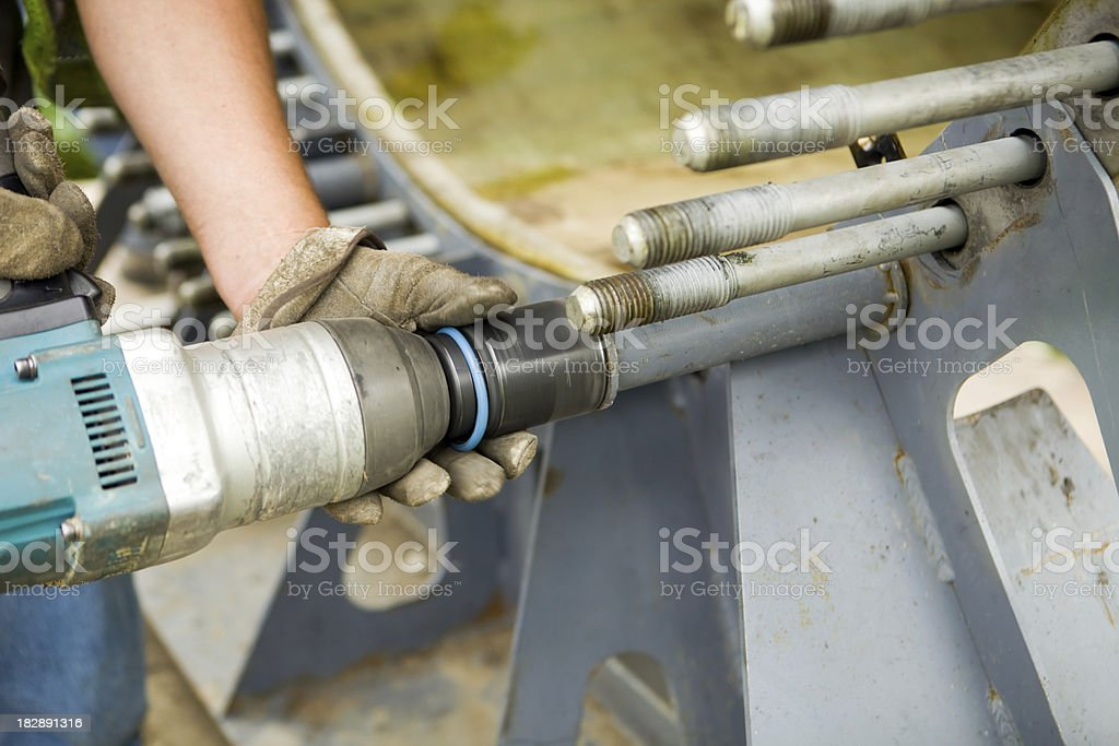 Impact Wrench Removing a Nut from Wind Turbine Blade Support stock photo