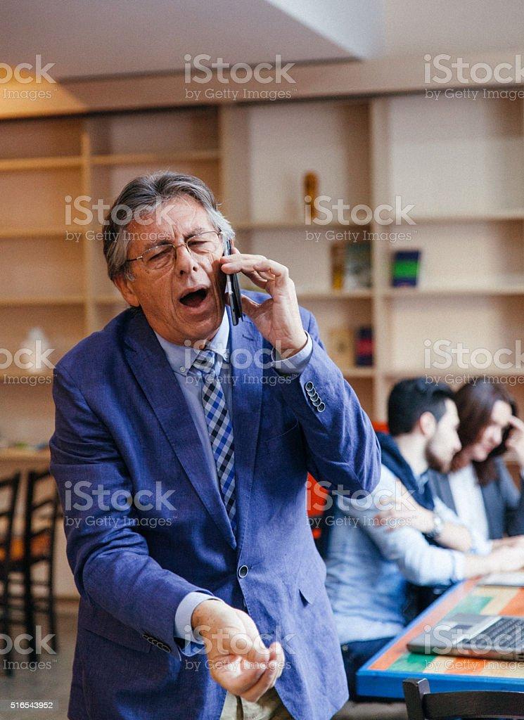 Impatient senior businessman stock photo
