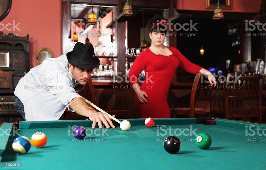 Impatient Woman and Oblivious Billiards Man stock photo