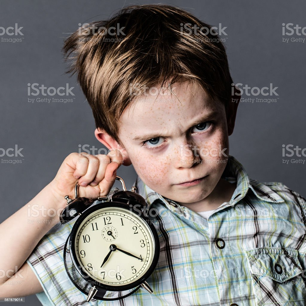 impatient young boy with a dark look reproaching alarming deadlines stock photo