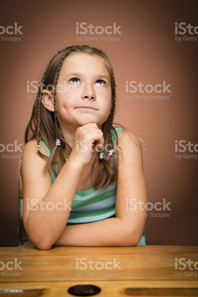 Impatient/Disgusted Young Girl Student Sitting at School Desk royalty-free stock photo