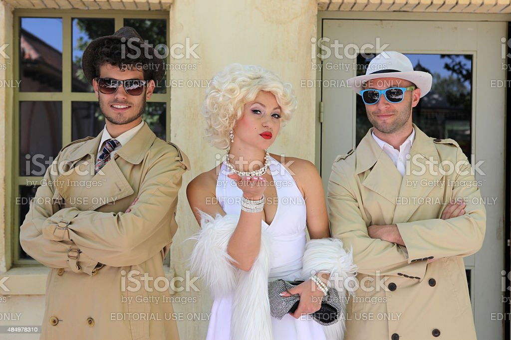 impersonator Marylin Monroe and boys in Barcelona stock photo