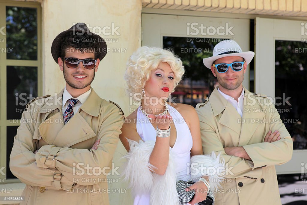 impersonator Marylin Monroe and boys stock photo